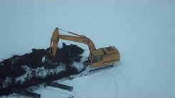 Laying Drainage Tile during a Minnesota Winter