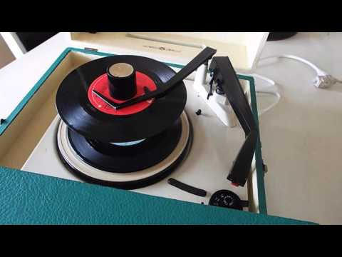 Voice of Music record player playing a short stack of 45's