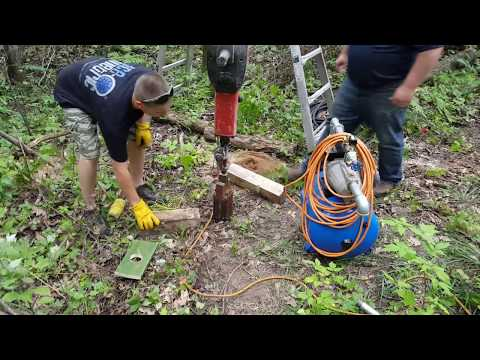 Driving a sandpoint well with a jackhammer