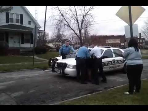 Toledo Ohio Lucas County Police arresting son and mother