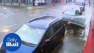 Black Peugeot crashes it's way through shop window in Birmingham