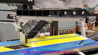 Fives Lund Slalom machine narrow carbon fiber tapes lanes closeup