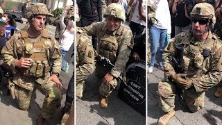 US National Guard members take the knee with protesters after Keke Palmer speech