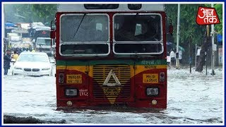 मुंबई में जल Curfew! डूबी पटरियां, लोकल लेट, विमानों पर ब्रेक!