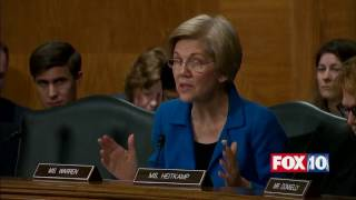 Sen. Elizabeth Warren TAKES ON Ben Carson at Confirmation Hearing for HUD Secretary thumbnail