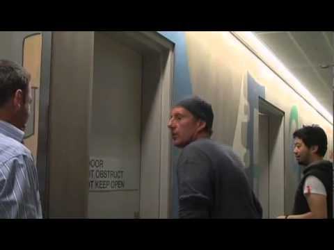 Art in an upstairs alley - David Bromley does a corporate mural (Trailer)