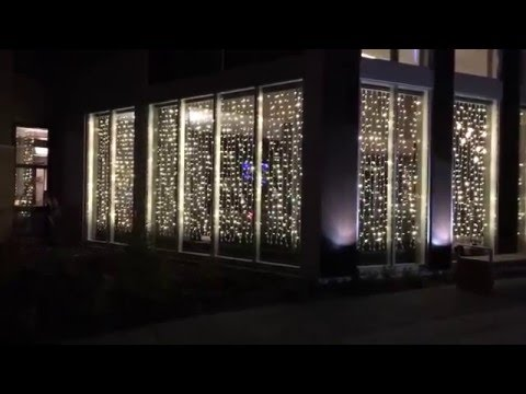 Southdale Place Exterior Christmas Light Curtains | Edina, MN | Roof to Deck Decoration