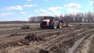 Versatile 550 Tractor pulling some pan scrapers in Illinois