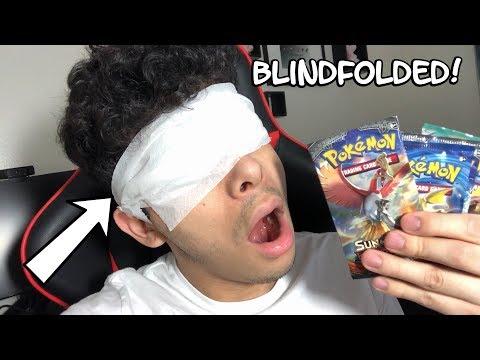 OPENING POKEMON CARDS BLINDFOLDED! (INSANE PULL!)