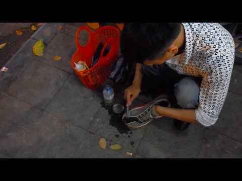 Fixing Shoes on the Streets Vietnam thumbnail