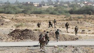 القوات العراقية تتقدم وتفتح طريقا للعائلات النازحة من القيارة