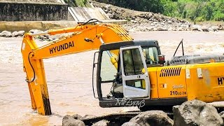 Excavators Dump Trucks Busy Working On River Dam