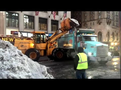 Getting Rid Of Snow, NYC Style DSNY Working With Private Contractor Front Loaders To Remove Snow