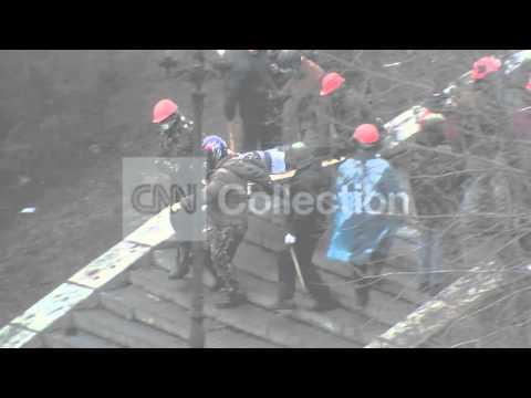 UKRAINE: PROTESTS - INJURED TAKEN (DRAMATIC)