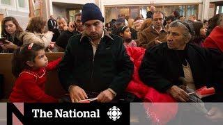 Asylum seekers flocking to Toronto overwhelm city's resources