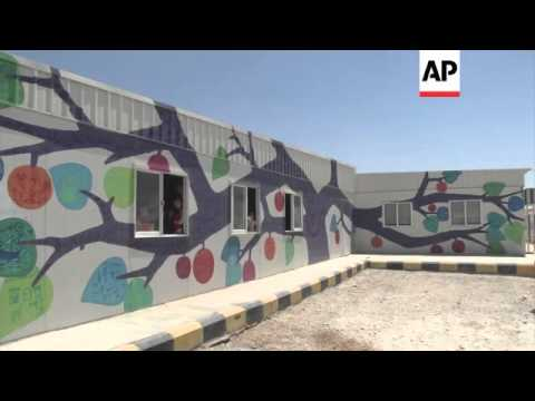 Artists and Syrian children beautify refugee camp in Jordan