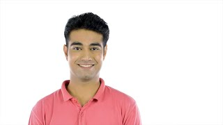 Closeup shot of an attractive Indian guy turning to the camera and smiling
