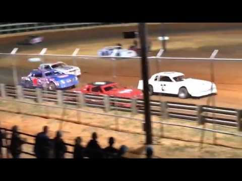 Some more action from Buffalo Creek Speedway on April 12th, 2019, when a lapped traffic ended up in a real ruckus with the lead pack. - dirt track racing video image