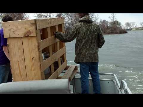 Placing A Big Wooden Fish Crib at the 2009 Wolf Lake Conservation Project