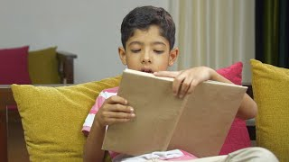 Closeup shot of a school boy reading a book very carefully - childhood education