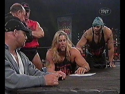 Goldberg & Kevin Nash sign a contract to fight on Starcade 1998.