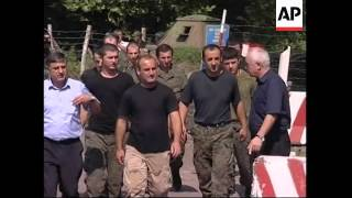 Russia frees Georgian soldiers, but tension persists