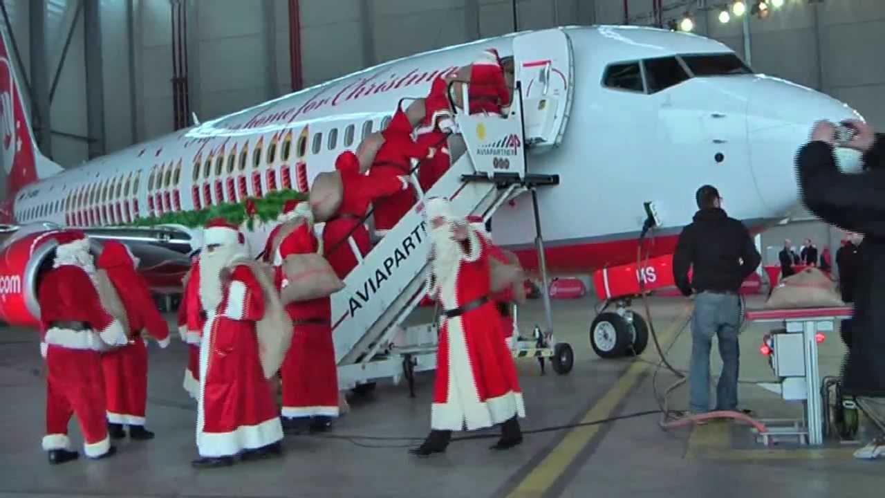 a dozen santa claus visiting the christmas aircraft merry santa of