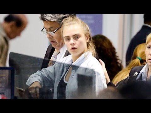 EXCLUSIVE - Cara Delevingne Looking Exhausted With NO MAKEUP At LAX