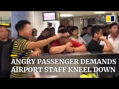 Angry passenger demands airport staff kneel down after flight got delayed
