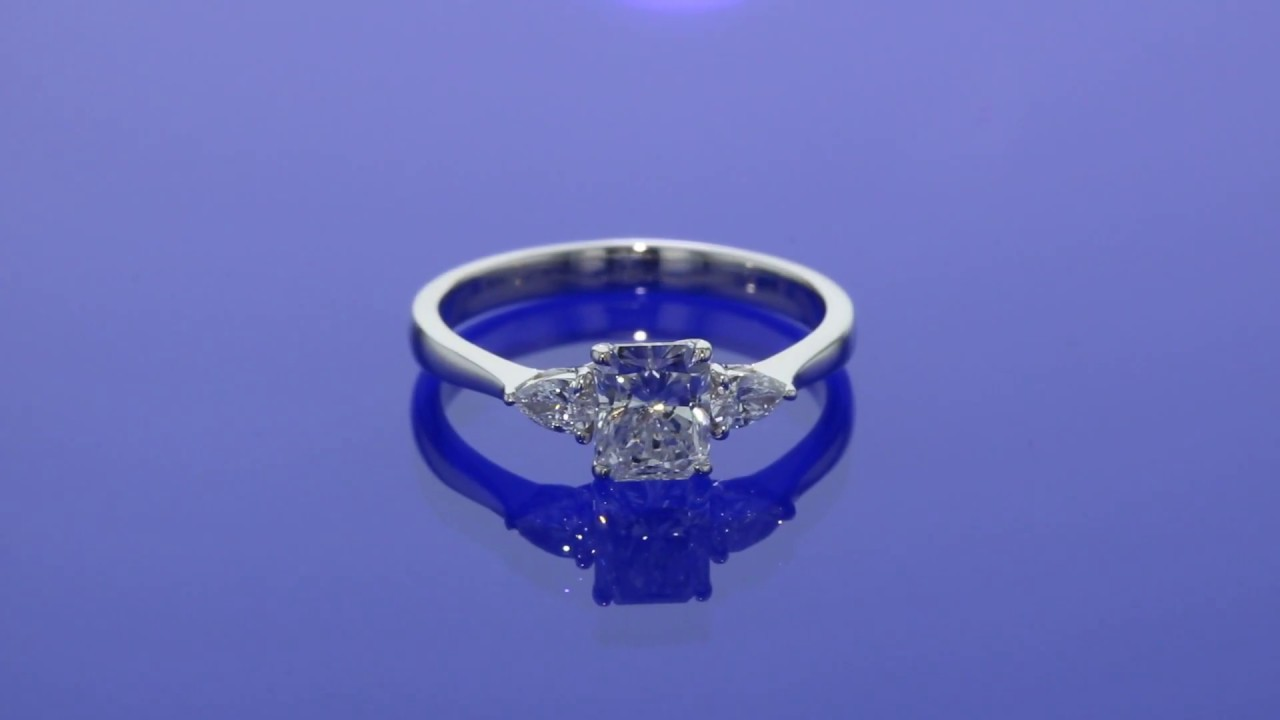 Cushion Cut Diamond Engagement Ring With Trillion Sidestones