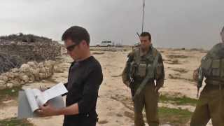 Occupation forces delivering demolition orders for renewable energy water pump system