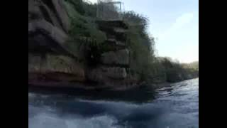 Man Jumps off Cliff, Lands Next to Great White