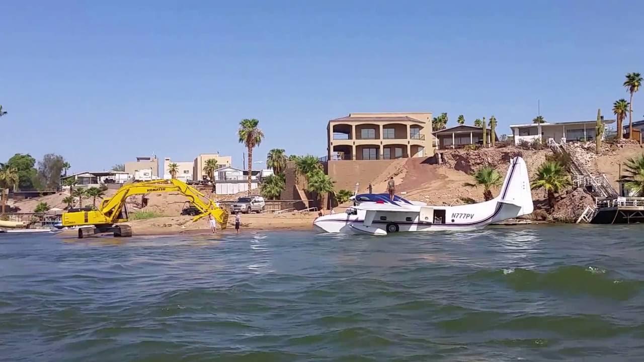 Plane lands on colorado river martinez lake youtube for Fishing license az price