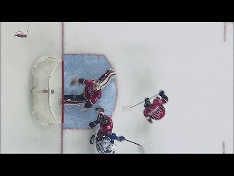 Calgary Flames' Jon Gillies snags a loose puck behind his back