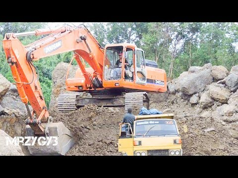 Large Digger Excavator And Overloaded Dump Trucks