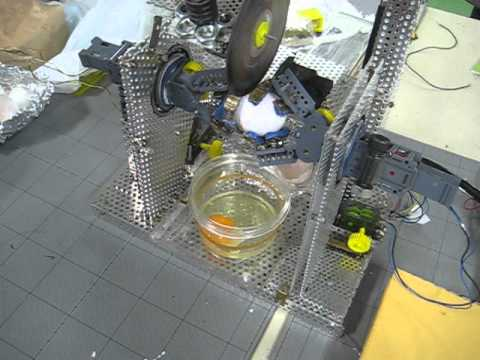Development of the automatic egg shell cutting machine using sequence control