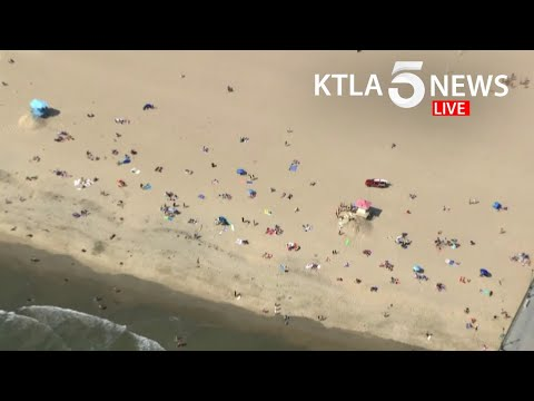 Groups Gather At Orange County Beaches A Day Before CA State-mandated Closures Begin