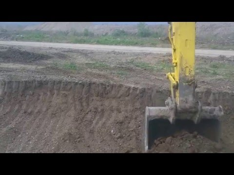 New Holland E305 excavating dirt part 2
