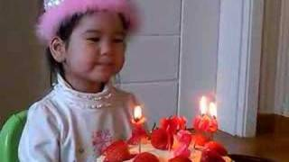 Llana blowing out candles