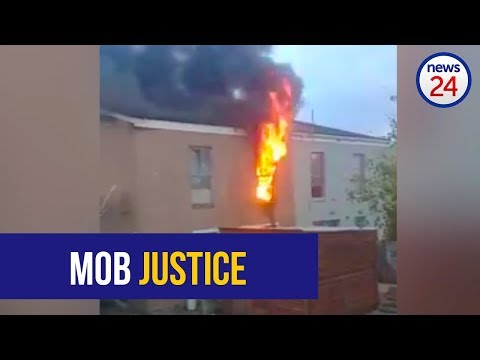 WATCH: Angry mob petrol bombs house after body of missing Mitchells Plain girl is found