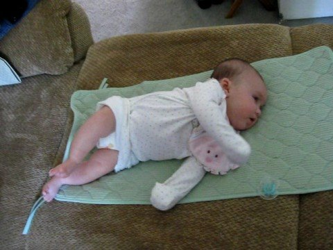 Baby trying to roll over