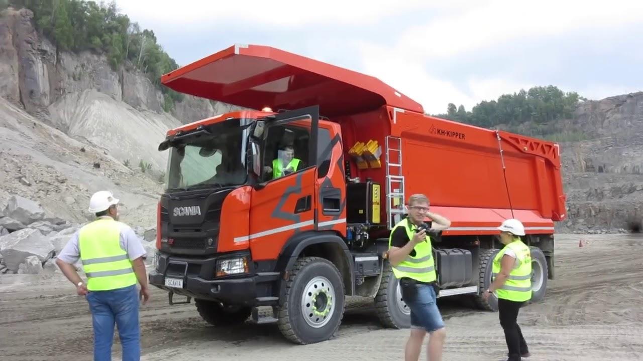 Скільки везуть самоскиди Scania G440 8х4 XT в гранітному кар'єрі