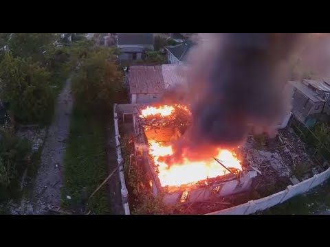 Drone Footage: Residential home burns after heavy overnight shelling in Donetsk