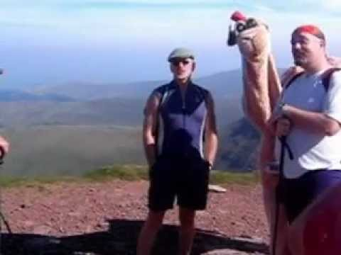 Male Choir singing with humphrey the camel at the top of Cribyn (Brecon Beacons, Wales)