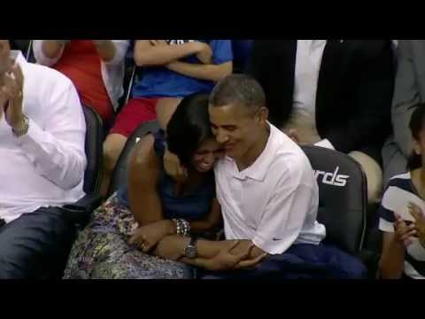 President Obama caught on 'Kiss Cam' Smooches Michelle Obama
