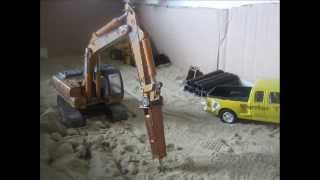 CASE CX210 AND VOLVO L70C BREAK UP HARD SAND
