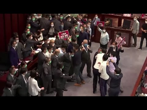 Pro-China and democratic lawmakers scuffle in Hong Kong legislature