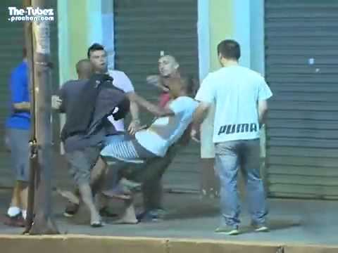 LiveLeak com   Swift kick of justice drops a thug as Brazilian taxi drivers conduct their own ''Citi