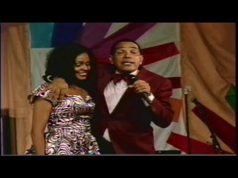 "G.B.T.V. CultureShare ARCHIVES 1990: JOHN AGITATION ""Comedian"" (HD)"