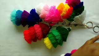 How to make woolen tassel bag charm very easily. Decorate bags with colorful charms.(in English)